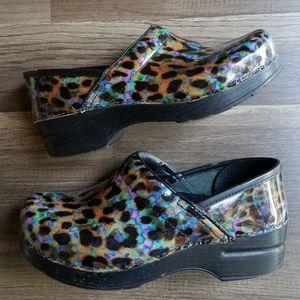 Dansko Rainbow Leopard Clogs